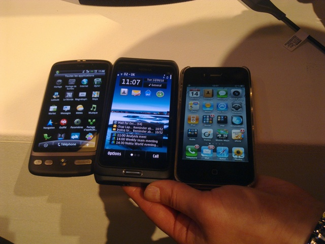Nokia E7 (middle) alongside HTC and iPhone 4 at Nokia World 2010