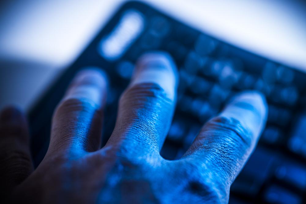 shutterstock hacker hand