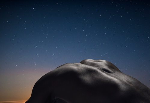 Male's back, night in the background, Getty Images Israel, Jonathan Knowles