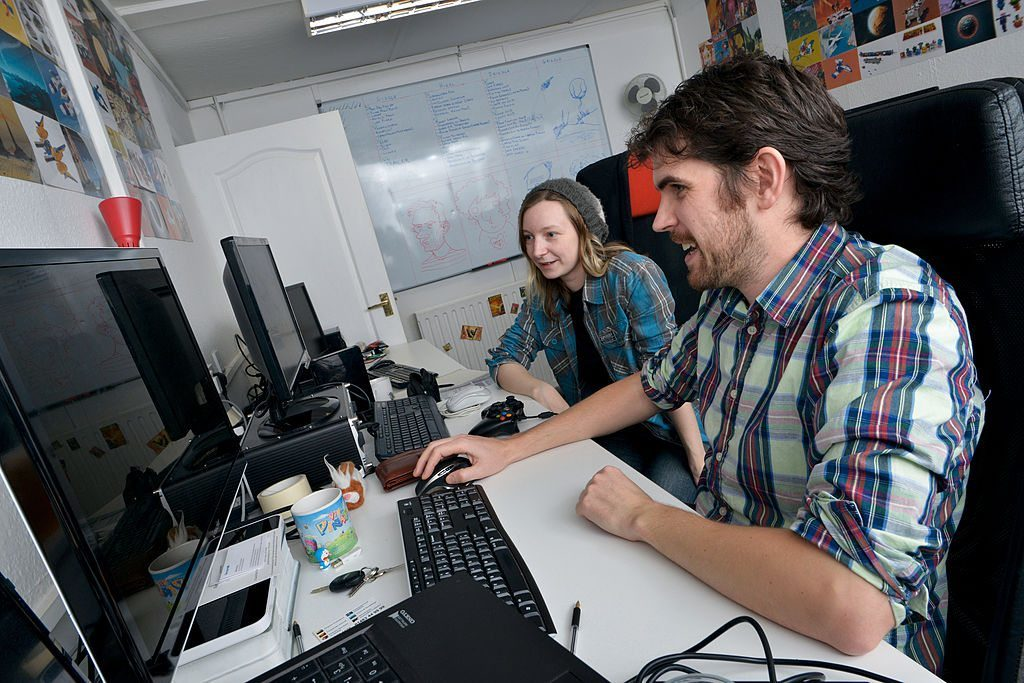 GUILDFORD, UNITED KINGDOM - DECEMBER 12: Sean Murray (R) and Hazel McKendrick of English video games developer Hello Games photographed at their studio in Guildford, on December 12, 2013. (Photo by Rob Monk/Edge Magazine via Getty Images)