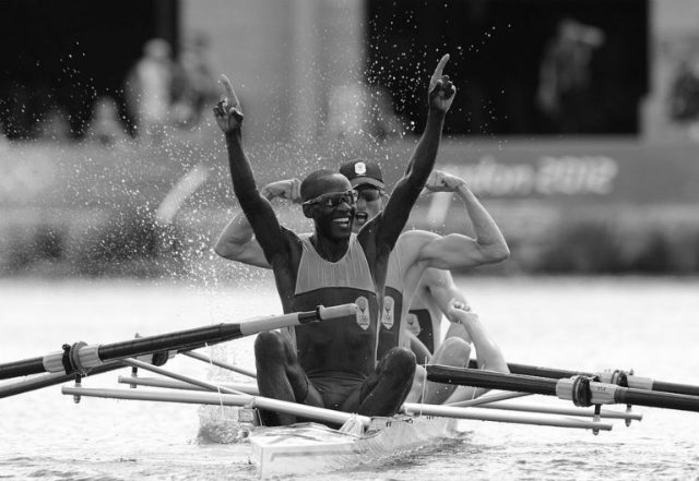 (Back to front) South Africa's James Thompson, Matthew Brittain, John Smith and Sizwe Ndlovu celebrate after winning the gold medal in the men's lightweight four final A of the rowing event during the London 2012 Olympic Games, at Eton Dorney Rowing Centre in Eton, west of London, on August 2, 2012. AFP PHOTO / POOL / DAMIEN MEYER