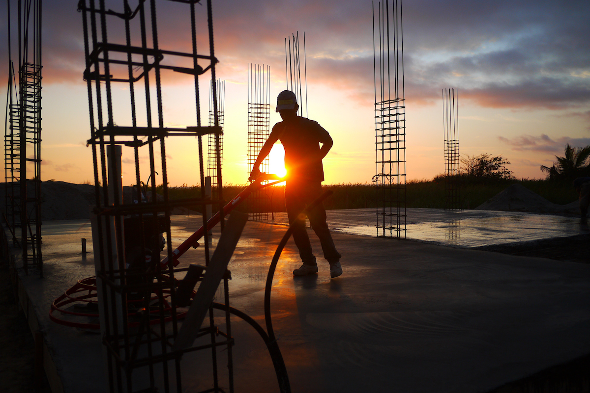 Construction Worker At Site During sunset getty images
