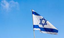 National Flag of Israel against blue sky