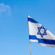 National Flag of Israel against blue sky